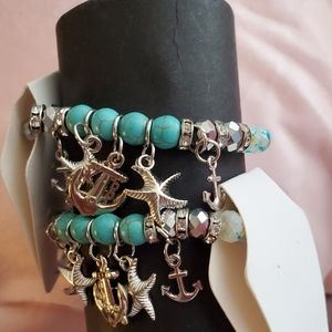 Bracelts silver tone with blue beads elastic type